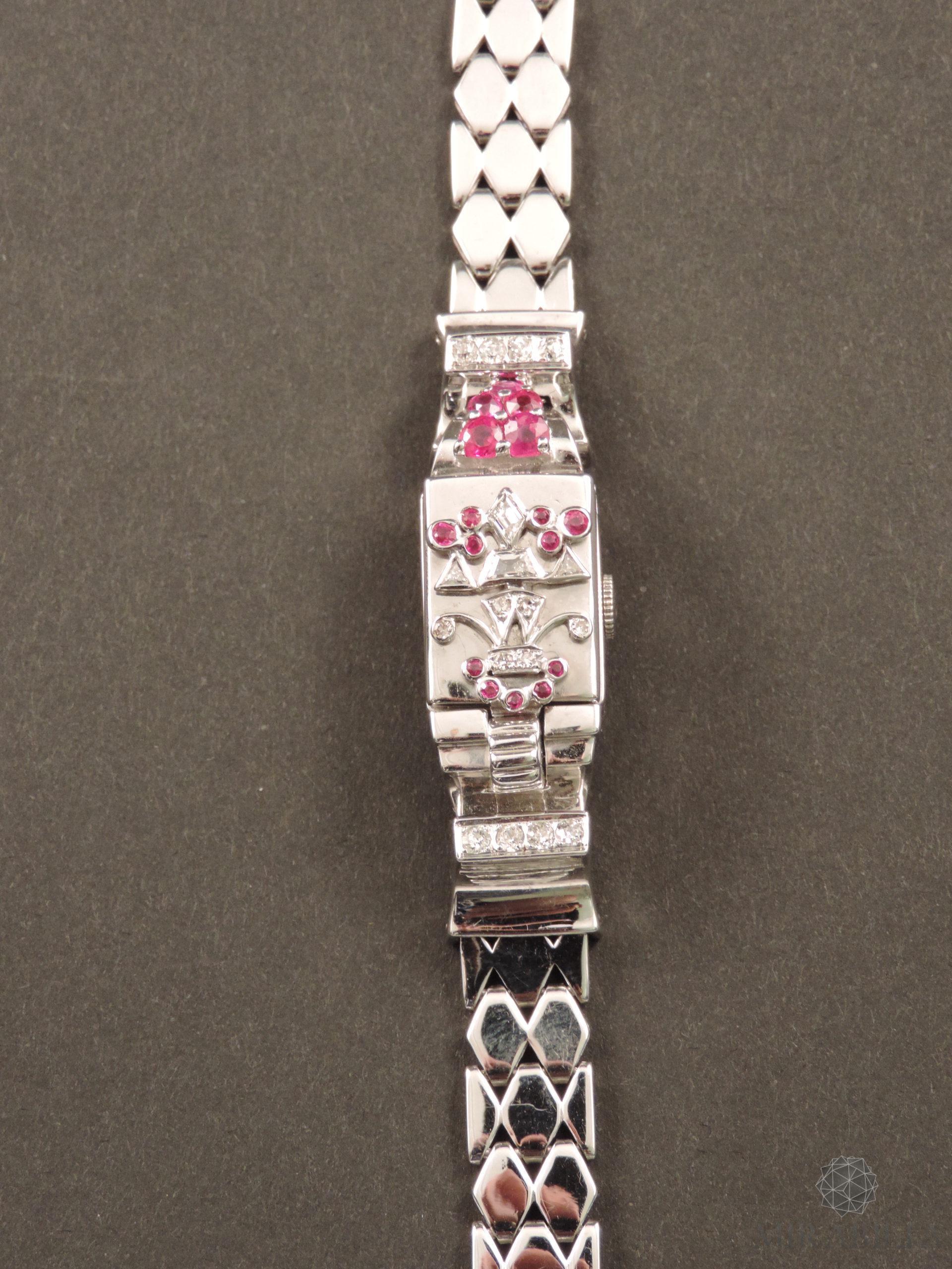 Orologio gioiello Lo Ros in oro bianco, rubini e diamanti Art Déco (Fronte Chiuso)