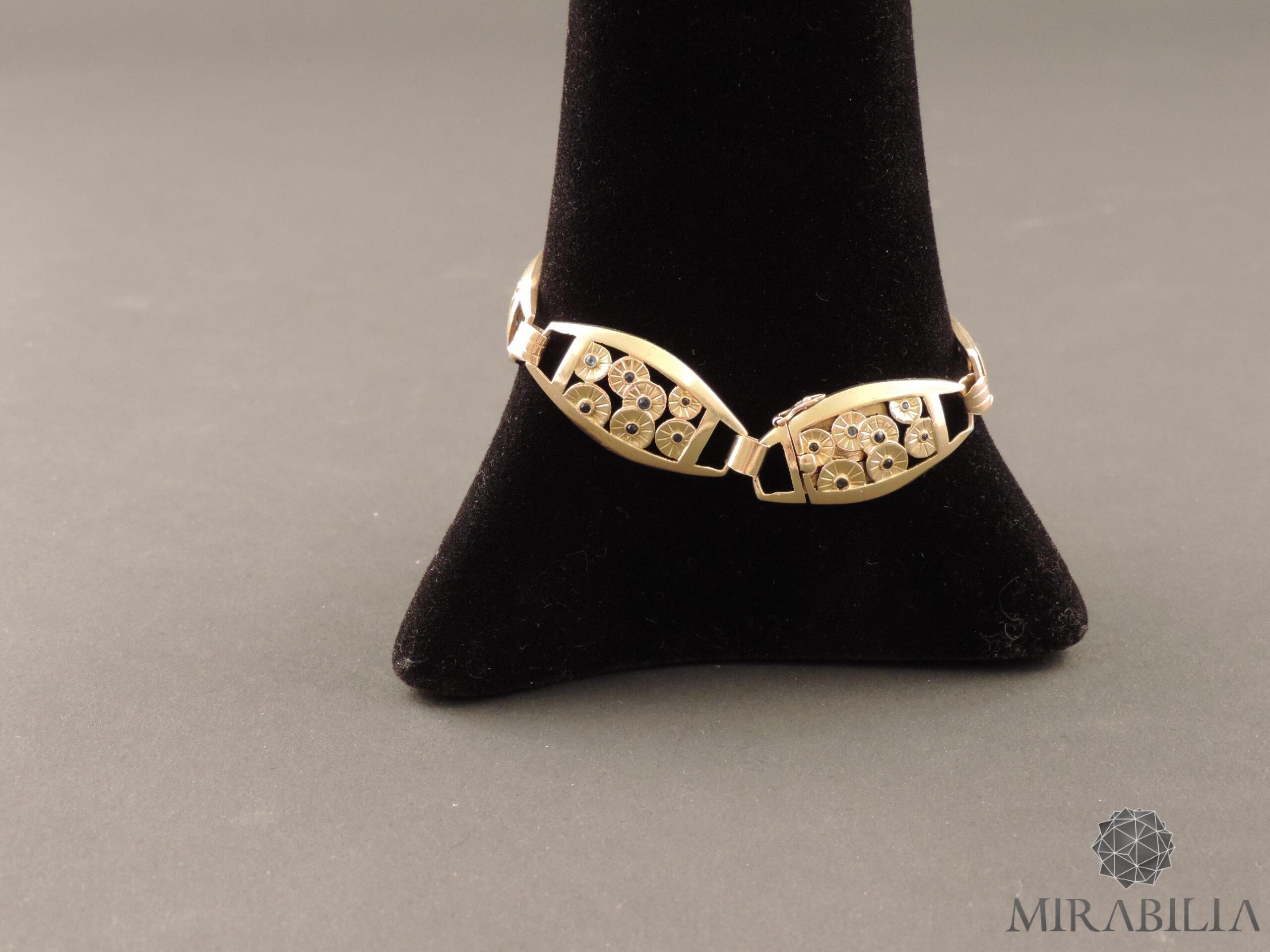 Braccialetto in oro giallo 18 ct. (750) e argento (800) formato da sei segmenti ovali,